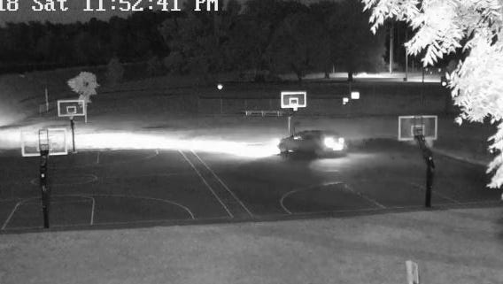 Vehicle seen driving on basketball courts at Rodger Young Park Saturday.