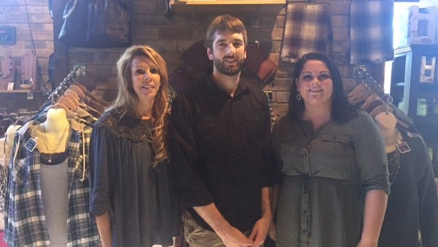 Urban Chic Boutique owner Jodi Krenz, general manager Jeremy Krenz and Rib Mountain store manager Ashley Hoppe at the Rib Mountain location.