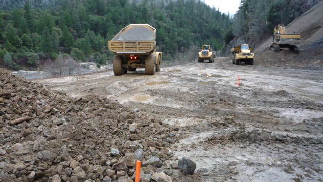 Crews clear out mud and rocks at Big French Creek on Highway 299, about 30 miles west of Weaverville.