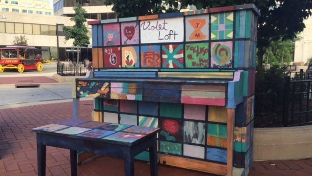 The original piano was painted during First Thursdays in June and July 2016. It was removed in early 2017 due to harsh weathering, but replaced with a new painted piano.