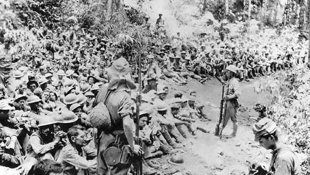 Troops rest during the Death March from Bataan to the prison camp at Cabanatuan. Sunday, April 9, 2017, marks the 75th anniversary of the march.