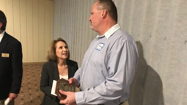 Ohio 6th District Court of Appeals Judge Arlene Singer talks to Joel Tuckerman at the Sandusky County Bar Association's annual Law Day. Tuckerman accepted the association's Liberty Bell award Friday on behalf of his mother, Barb, a former Sandusky County Board of Elections director who died in February.
