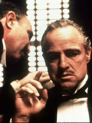 "Marlon Brando, right, stars as Don Corleone in the classic movie, ""The Godfather."" The film, which debuted 45 years ago, will be screened at 2 and 7 p.m. Sunday and Wednesday in various El Paso theaters."