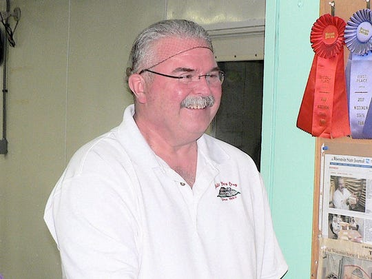 Myron Olson is a master cheesemaker in three cheeses and longtime manager of Chalet Cheese Co-op in Monroe.