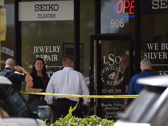 Crime scene investigators search for clues following