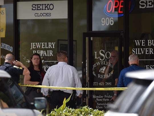 Crime scene investigators search for clues following an armed robbery at LSO Jewlers in St. Lucie West.