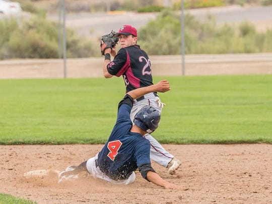 South Troy's Nick Kondo tries to turn a double play against Southern Nevada on Saturday at the Farmington Sports Complex.