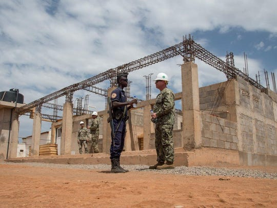 U.S. Navy Lt. Cmdr. Jason Ward of Henderson, right, chats with one of the Djiboutian Gendarmerie who helped secure Navy Seabees on a construction site at Ali Oune, Djibouti, where they were building a medical center, Aug. 17, 2017.