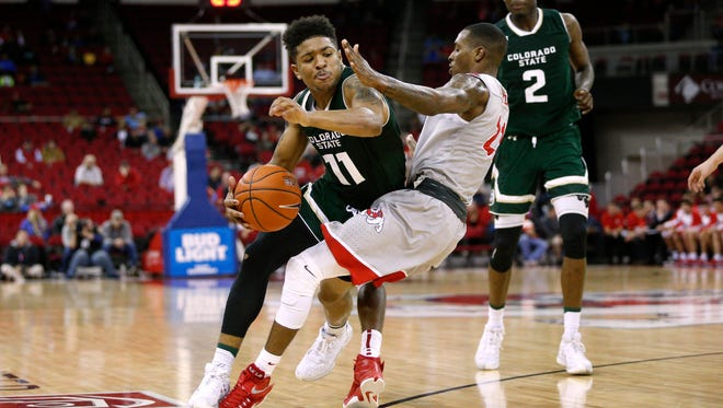 CSU's Prentiss Nixon is fouled by Fresno State's Deshon Taylor while driving for a basket Wednesday night at the Save Mart Center in Fresno, Calif. Fresno State won the game 78-57, handing CSU its most-lopsided loss in more than three years.