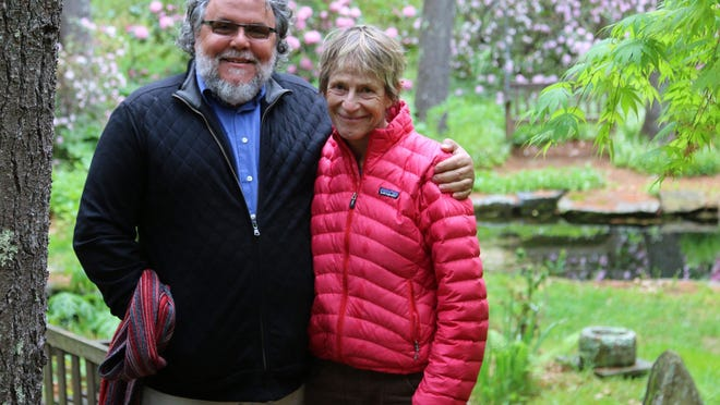 In this June 2017 photo, John Forti, executive director of Bedrock Gardens in Lee, stands with Jill Nooney, who owns the 37-acre property with her husband Bob Munger.