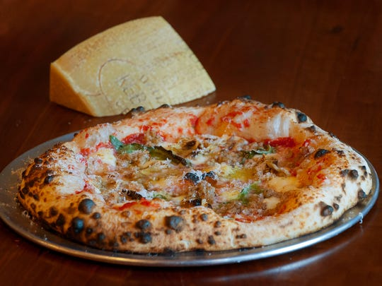 Lupo Restaurant's salsiccia pizza is made with tomato,