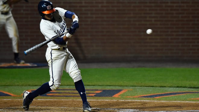Will Holland (17) was 2 of 4 with a career-high 4 RBIs including a 2-run home run in Auburn's 14-3 win over No. 5 Florida on Friday, March 17, 2017 in Auburn, Ala.
