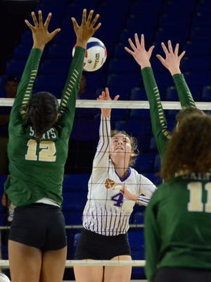 Father Ryan's Olivia Rolick (4) attempts a kill over Briarcrest's Alyiah Wells (12) during Friday's Division II-AA championship match.