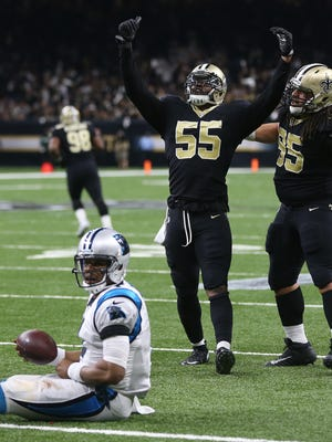 Saints linebacker Jonathan Freeny (55) reacts with defensive tackle Tyeler Davison after tackling Panthers quarterback Cam Newton during the third quarter of an NFC wildcard playoff game on Jan. 7.