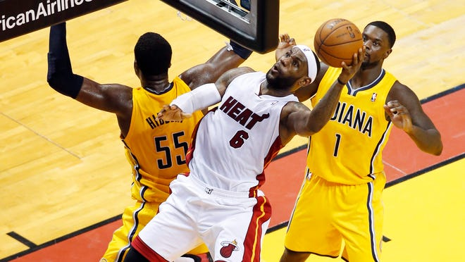 Miami Heat forward LeBron James (6) shoots between Indiana Pacers center Roy Hibbert (55) and guard Lance Stephenson (1) during the first half in game six of the Eastern Conference Finals of the 2014 NBA Playoffs at American Airlines Arena.