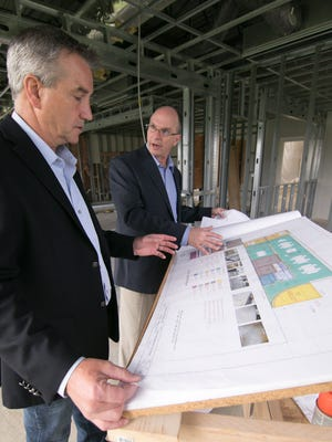 IEC North America President Mike McLean, left, and IEC Fabrication President Brad Salutes discuss architectural plans for ongoing renovations at their Fowlerville manufacturing facility, Friday, May 4, 2018.