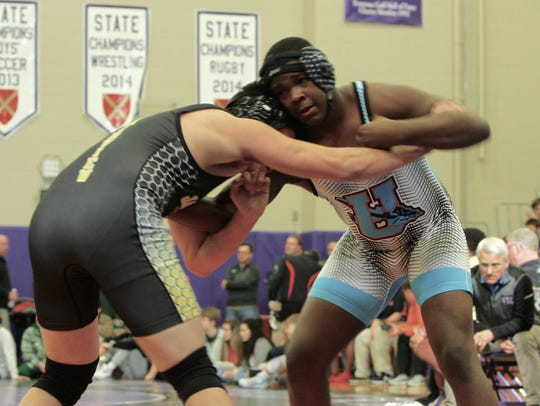 Darius Moore starts his match in the Father Ryan tournament.