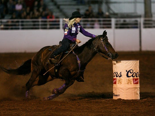 Amberleigh Moore of Keizer, Ore., competes in barrel