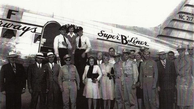 Edwin Rhea Mitchell, top left, with the passengers and crew of the first commercial flight to land in Lubbock.