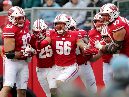 Oct 12, 2019; Madison, WI, USA; Wisconsin Badgers linebacker Zack Baun (56) celebrates with his teammates after his touchdown after an interception and 34 yard return during the 2nd half against Michigan State at Camp Randall Stadium.  Mandatory Credit: Mike De Sisti/Milwaukee Journal Sentinel via USA TODAY Sports