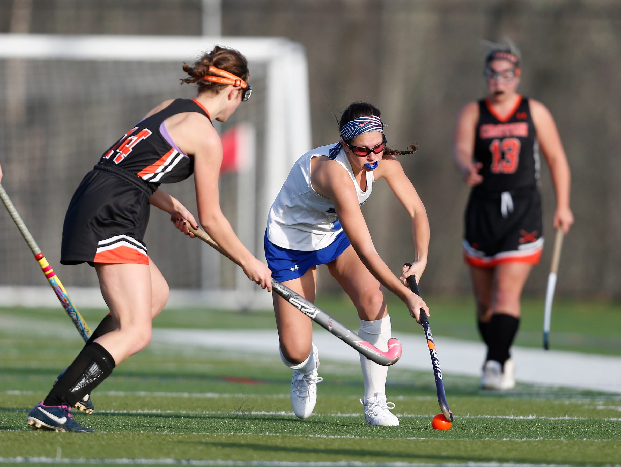 Bronxville's Arielle Vergara (1) works the ball past Croton's Katherine Gennarelli (14) during their 7-1 win in the Class C field hockey sectiion finals at Brewster High School on Tuesday, November 1, 2016.