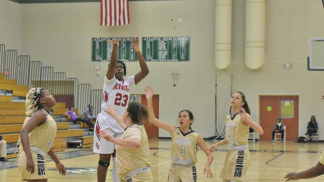 During a game this past season, Seminole Ridge's Jahnae Midget fires a shot from beyond the arc.