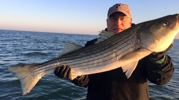 Charlie Hendrickson with a nice bass he caught in Brigantine. 12/6/15.