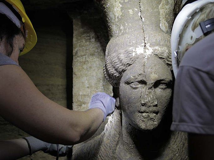 One of two female figures serving as supports, or caryatids, stands inside the Kasta Tumulus tomb on Sept. 7 in Amphipolis, northern Greece. The 7 foot-tall stone maidens guard a mysterious tomb that dates to the age of Alexander the Great.