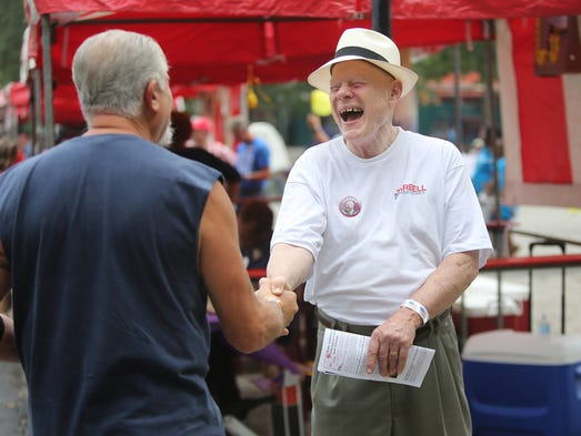 Jim Tarbell shakes hands with a supporter at the Cincinnati AFL-CIO's annual labor day picnic at Coney Island on Monday September 1, 2014.  The picnic takes place this year with one notable difference from past years: No political speeches. Past years have seen visits from President Obama, VP Biden, Labor Secretary Perez and others.  Tarbell is running for Hamilton County Commissioner.