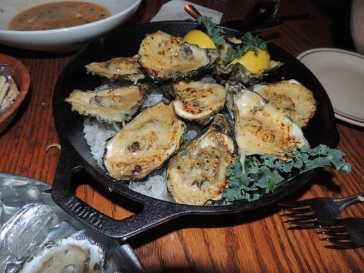 Char-grilled oysters cooked in their own juices on a grill, then topped with Parmigiano Reggiano cheese, butter and garlic and flash broiled.