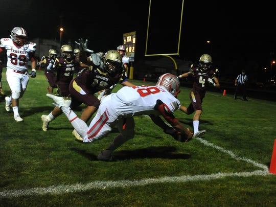 Truckee's Marcus Bellon (28) dives for a score against Sparks during their football game in Sparks on Oct. 6.