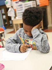 Javion Tanksley works on a drawing of what the future will look like at Kodak Park School 41.