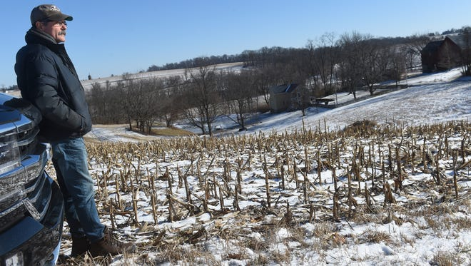 """""""I feel like they're robbing my farm from me,"""" said Kent Blevins, of Blevins Fruit Farm. He has joined other in fighting a proposed power line that would make its way through his Hopewell Township property."""