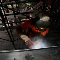 A work attaches metal framing during construction of South Louisiana Community CollegeÕs ÒmilestoneÓ building in Lafayette May 26, 2016.