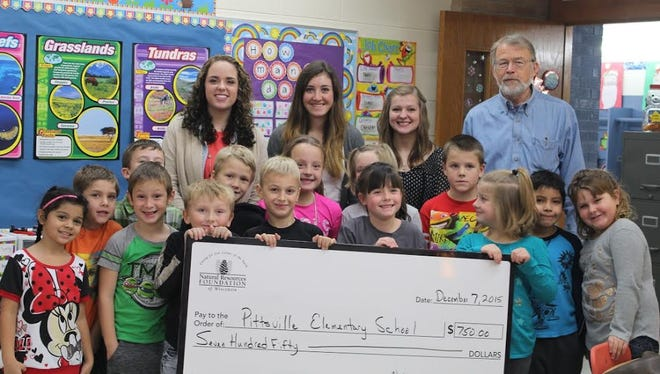 Pittsville High School received a Teachers' Outdoor Environmental Education Grant Award. This award grants money to public school teachers who undertake environmental education projects. Peter Oslind presented the check to Mrs. Blaser's class on behalf of the entire elementary school.