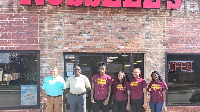 Russell Hodges (owner of Russell's Pizza) and Lions Club member D.J. Washington with Blackville-Hilda High graduates Tyreek Brown, Arianna Gibson, Nyla Jenkins and LaSasha Simmons.