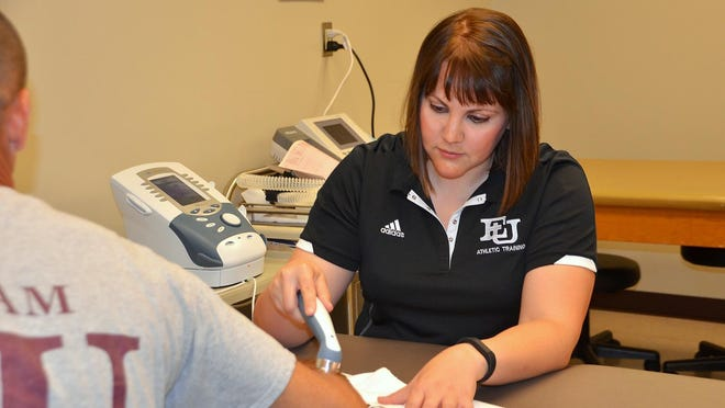 Sarah Walters, athletic training program director at Evangel University, treats athletic injuries with therapeutic ultrasound.