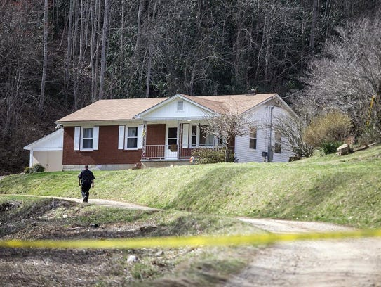 Buncombe County sheriff's deputies in March investigate