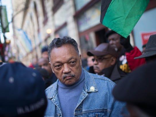 Rev. Jesse Jackson leads Chicago demonstrators in December