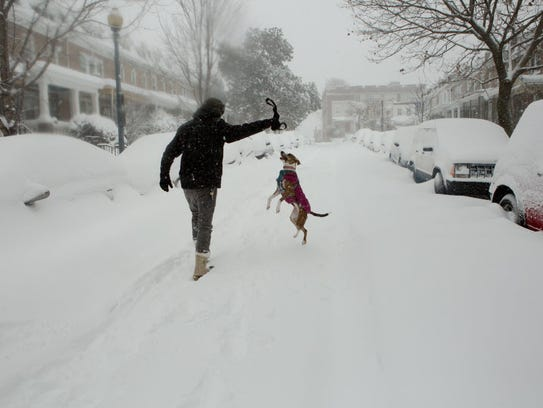 A man takes advantage of an unplowed street to play