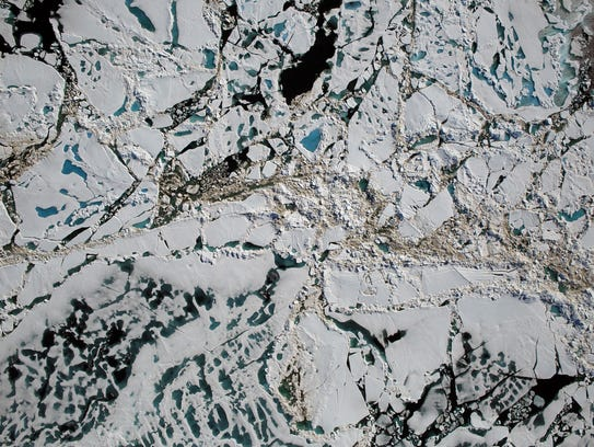 Chunks of sea ice, melt ponds and open water are all