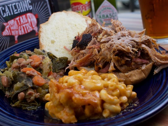 A pork barbecue sandwich at Sweet P's with sides of