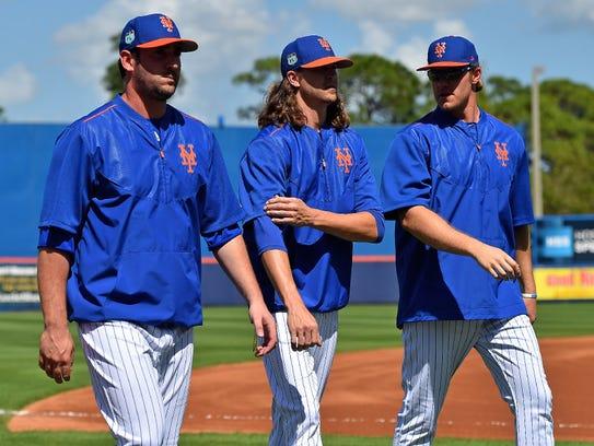 Matt Harvey (L), Jacob deGrom (C) and Noah Syndergaard