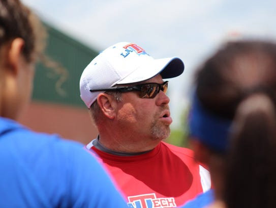 Louisiana Tech coach Mark Montgomery talks to his players