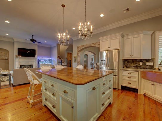 The kitchen is luxurious and functional all at once.