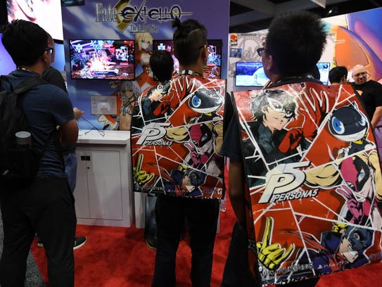 Video game fans wait for an opportunity to play Fate/Extella: