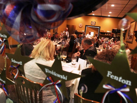 In 2012, Bob Colaneri (center) Vice President of Nam Knights Motorcycle Club of America, prays together with other participants during a dinner to honor the Gold Star Mothers of our area who lost sons in Iraq and Afghanistan in recognition of Gold Star Mothers Day held by the Nam Knights Motorcycle Club of America at Casa Qiuseppe in Lyndhurst.