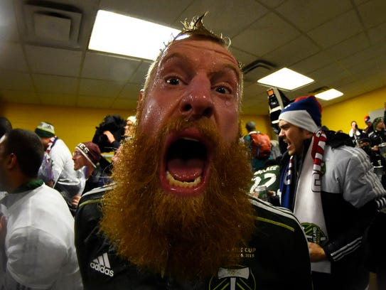 Nat Borchers celebrates in the locker room after the