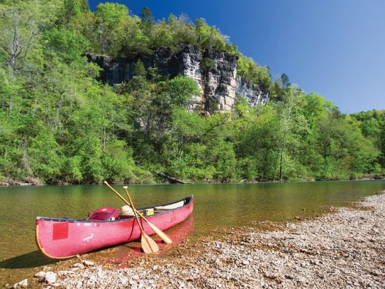A canoe waiting to head downstream on a bright May