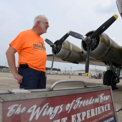 Charles Brozina, of Millville, looks at the B-17 bomber